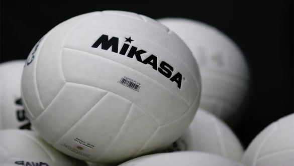 "A pile of volleyballs with the word ""mikasa"" on it."